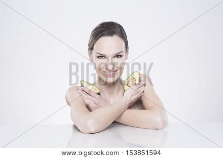 Young Woman Keeping Avocado