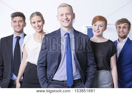 Smiled Employees At Work Office