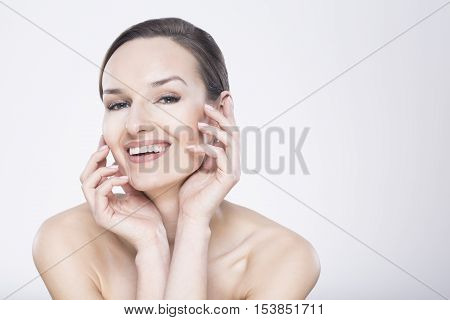 Pretty Woman Touching Her Face
