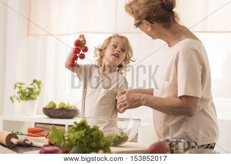 Grandma Cooking With Grandchild