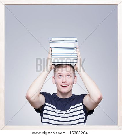 Student Keeping Books On His Head
