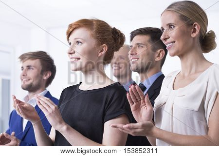 Office Employees Clapping Their Hands