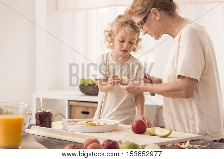 Child Helping Grandmother With Baking