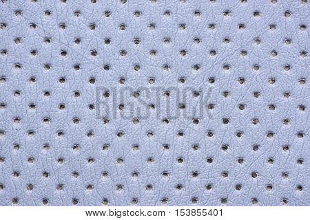 Close up blue perforated leather texture background