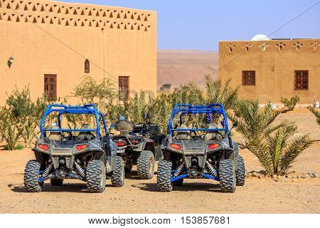 Itrane Morocco - Feb 24 2016: blue Polaris RZR 800 with no pilot parked in a small Berber village in Morocco desert near Merzouga
