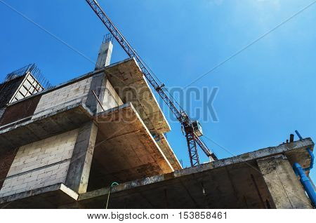Construction site with cranes on blue sky background