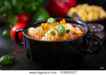 Minestrone, Italian Vegetable Soup With Pasta On Black Backgrounds.