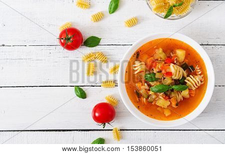 Minestrone, Italian Vegetable Soup With Pasta On White Wooden Table. Top View