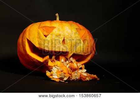 jack o lantern puked entrails big orange pumpkin on a black background