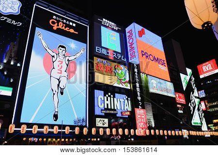 OSAKA JAPAN - JUL 9 2016: The Glico Man billboard and other light displays on JULY 9 2016 in Dontonbori Namba Osaka area Osaka Japan. Namba is well known as an entertainment area in Osaka.
