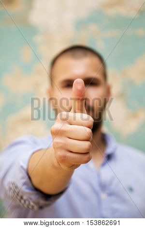 Man showing okay sign with the thumb