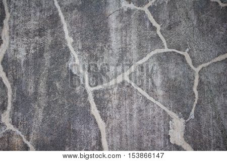 Abstract distressed background on stone, black and white striations