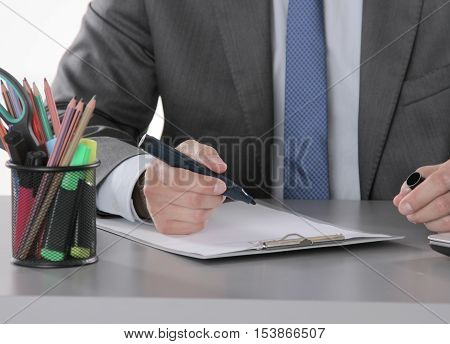 Portrait Of Business Man Hand Writing At Notebook And Holding Mobilephone