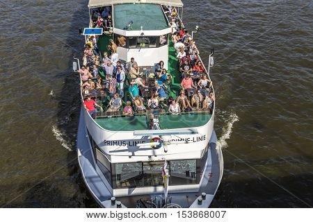 People Enjoy The Trip On River Main On A Sunny Day