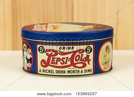 RIVER FALLS,WISCONSIN-OCTOBER 28,2016: A vintage Pepsi tin on white with a wood background