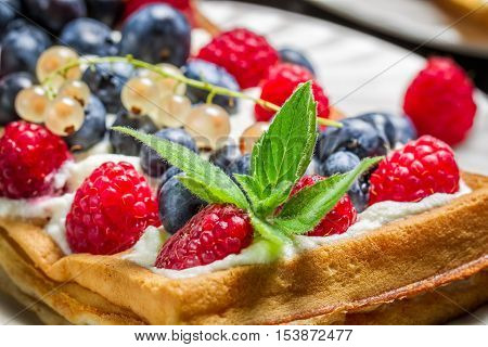 Closeup Of Waffels With Cream And Berry Fruits