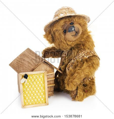 Teddy bear beekeeper in classic vintage style isolated on white background