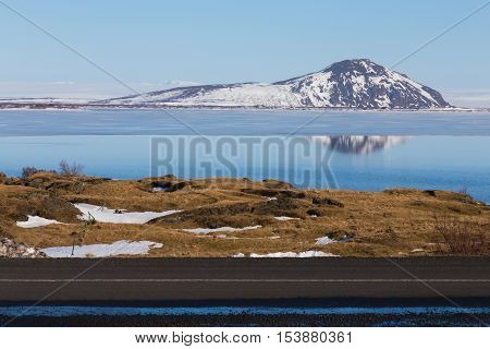 Snow cover mountain background over the lake winter season, Iceland winter landscape background