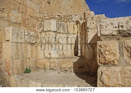 Inside a medieval castle arrow slit in the historic wall of Old Jerusalem, Israel.