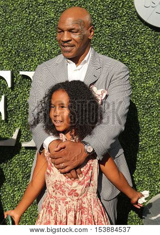 NEW YORK - AUGUST 29, 2016: Former boxing champion Mike Tyson with daughter attend US Open 2016 opening ceremony at USTA Billie Jean King National Tennis Center in New York