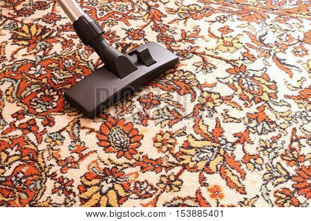 cleaning old carpet with a vacuum cleaner universal nozzle