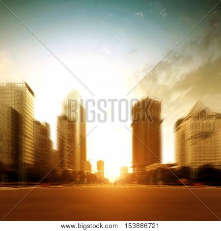 Dusk modern city high-rise building and road.