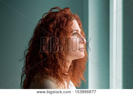 Attractive Young Woman Standing Daydreaming