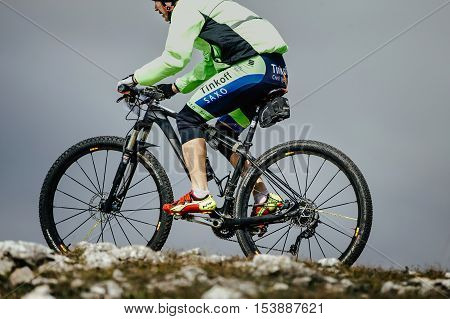 Privetnoye Russia - September 21 2016: closeup of a male cyclist mountainbiker sports bike during Crimean race mountainbike