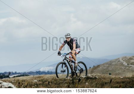 Privetnoye Russia - September 21 2016: male cyclist mountainbiker on sports bike in mountains during Crimean race mountainbike