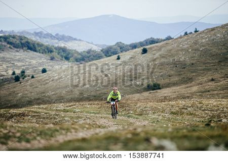 Privetnoye Russia - September 21 2016: male riders cyclist rides on a mountain trail mountain bike during Crimean race mountainbike