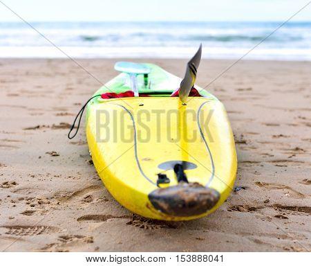 Multicolored canoe on the beach, selective focus.