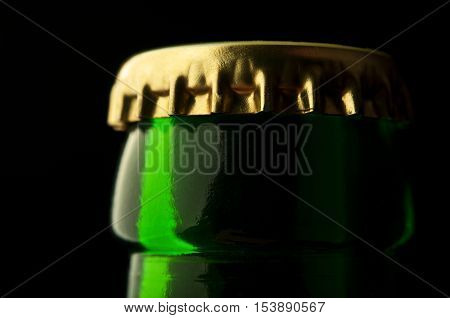 closeup of beer bottle on black background