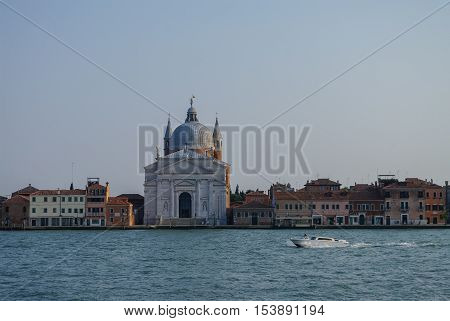 View on La Giudecca island with basilica del Redentore on the sunset in Venice. Italy