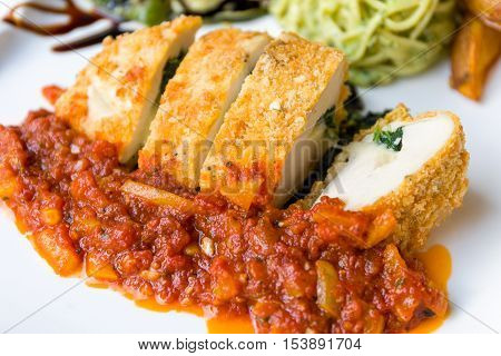 Fried Chicken With Bread Crumbs With Tomato Sauce