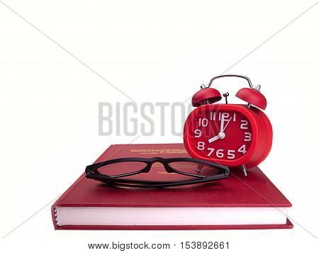 Alarm clock and books Glasses Put on a white background.(Space for placing text)
