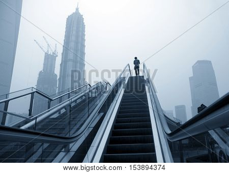 Shanghai street modern building skyscraper building escalator.