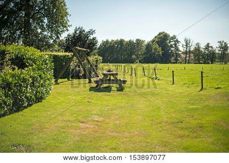 Wooden Picknick Table In Garden. Winterswijk. Achterhoek. Gelderland. The Netherlands.
