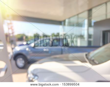 Abstract blur showroom interior for background.office car blurry sales.blurred business shop new bokeh center color desing desk focus white work photo inside auto bright rush person speed team suit.
