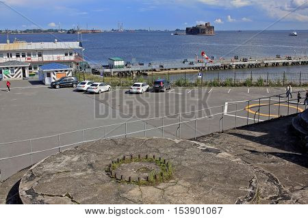 Kronstadt Russia - July 10 2016: View of the Fort Alexander (Plague Fort) and a pier from Fort Constantine. The forts of Saint-Petersburg is a complex of permanent fortifications at different times built to protect the capital from attack from the sea.