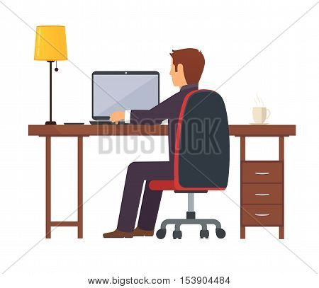 Businessman programmer works on a portable laptop computer at the office desk.