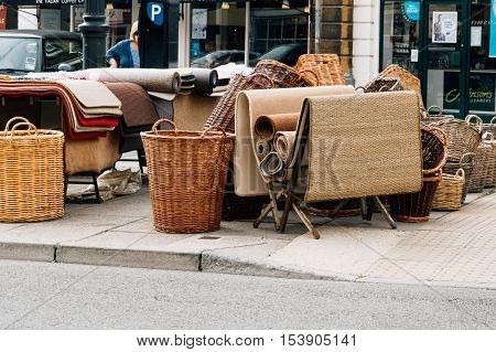 Cirencester UK - August 17 2015: Wicker baskets and rugs in the Market Place of Cirencester. The city is a market town in the cotswolds and is known to be an important early Roman area.