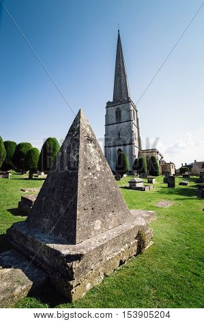 Painswick UK - August 17 2015: Pyramidal tomb in the churchyard of St Mary's Church. Painswick is a town in the Cotswolds originally the town grew on the wool trade.