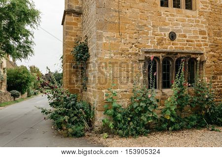 Stanton UK - August 17 2015: Delightful corner of a typical limestone house in the center of the village. It is one of the prettiest and idyllic villages in the Cotswolds.