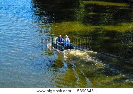 The concept of Love for all ages. Romantic love - in this world there are only we and nobody else. Romantic date on an inflatable boat