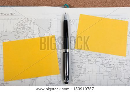 World Atlas Diary Book With Yellow Paper Note. Open Diary Map Book With World Map With Pen. Black Pe