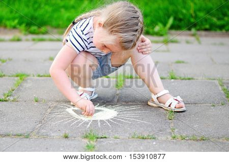 Adorable Little Girl Drawing Outside With Chalk