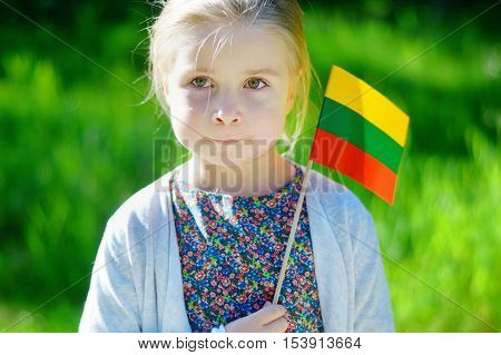 Adorable Little Girl Holding Tricolor Lithuanian Flag