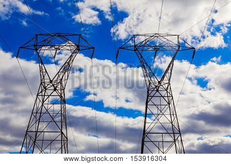 Overhead Power Lines In A Cloudy Winter Sky