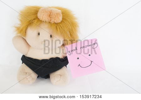 good morning card and baby doll on background white