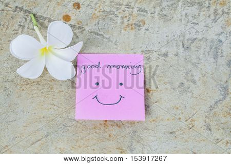 good morning message card greeting and little white flowers on background old wood